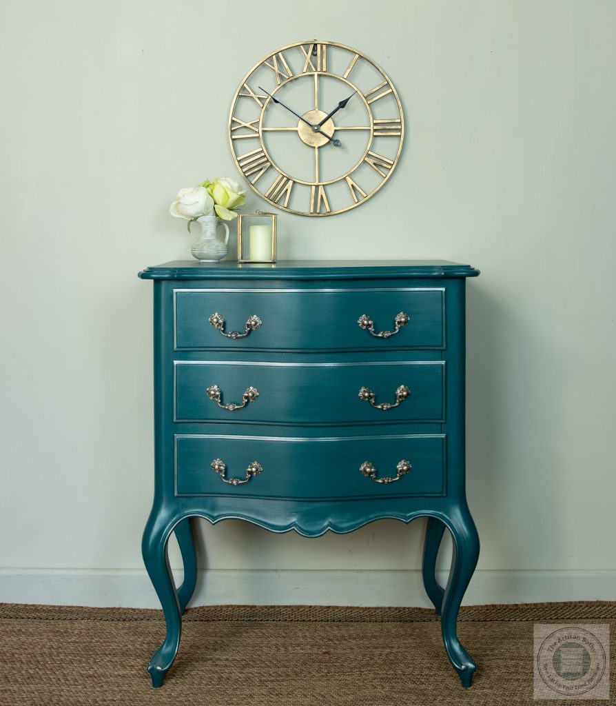 Chest of three drawers on shaped legs painted in a rick jewel teal peacosck shade