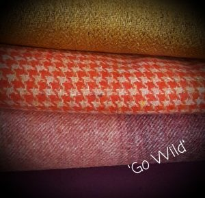 stack of colourful tweed fabrics
